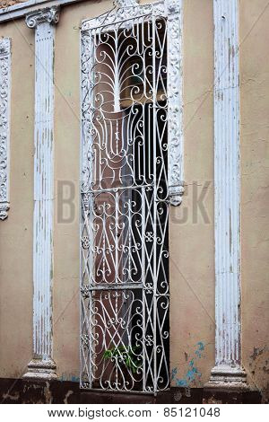 door with bars in the old building