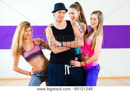 Man posing with woman in dance school