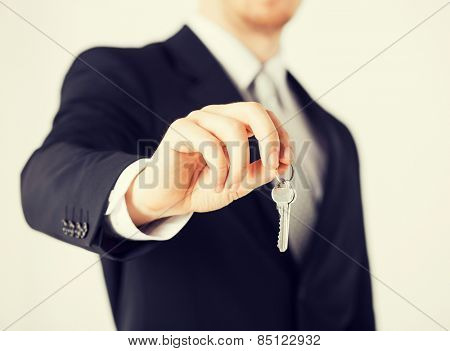 bright picture of man hand holding house keys