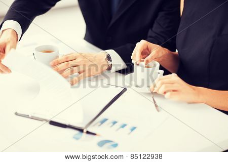 picture of woman hand signing contract paper
