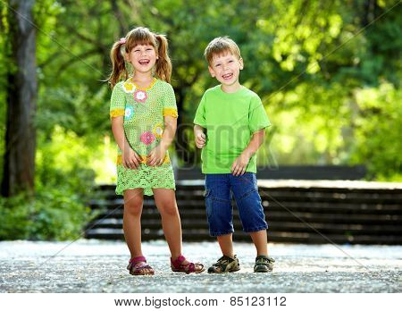Happiness smiling boy and girl fun outdoor under sunlight