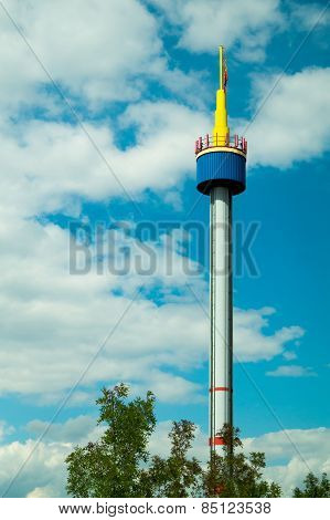 Bright Tower Against The Blue Sky With White Clouds