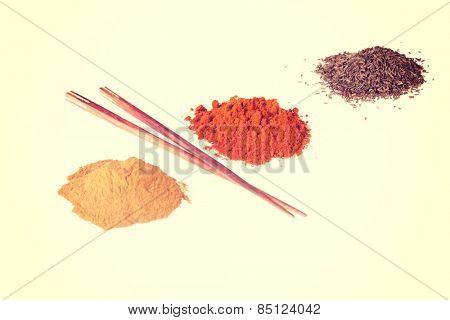 Curcuma or curry pepper and chili pepper spices.