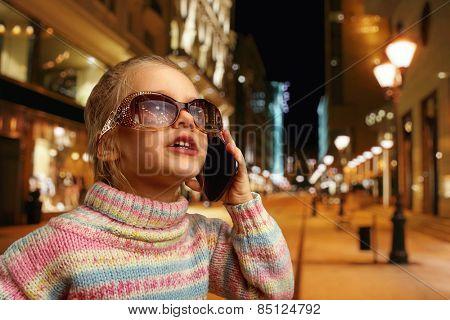 Cute little girl talks on phone