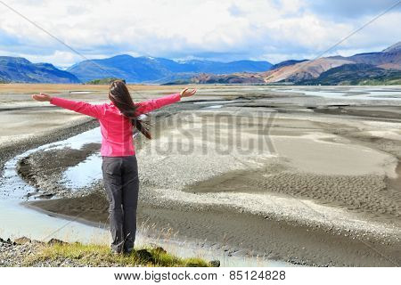 Woman enjoying view of Iceland black sand dunes in south Icelandic nature landscape. Serene person relaxing soaking in the natural beauty. Tourist visiting landmarks tourists attractions.