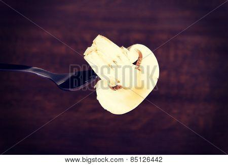 One sliced mashroom on a fork.