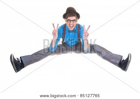 goofy, nerd geek jumping and shouting with v sign