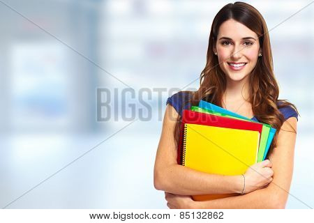Young beautiful student woman portrait. Education background.