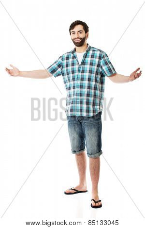 Young caucasian man showing big size with hands.