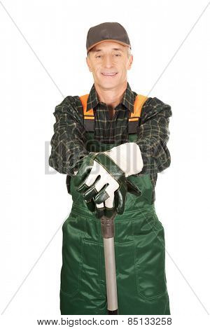 Smiling experienced gardener with a spade