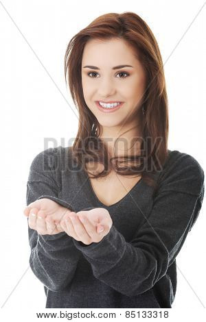 Smiling woman holding something imaginary on hands