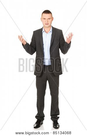 Frustrated young businessman with open hands