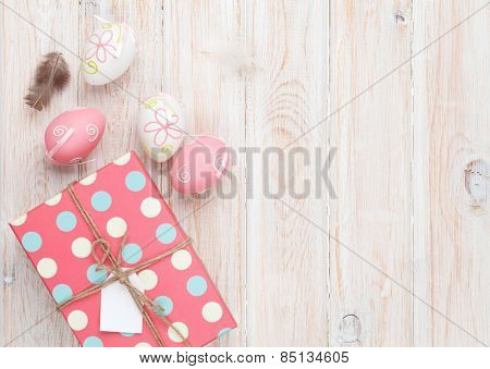 Easter eggs and gift box. Top view with copy space