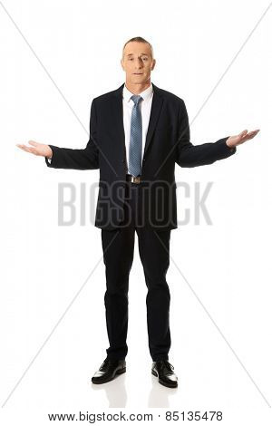 Businessman holding something invisible in both hands