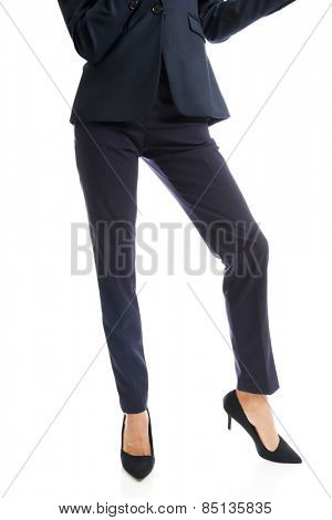 Close up on businesswoman slim legs in high heels standing astride.