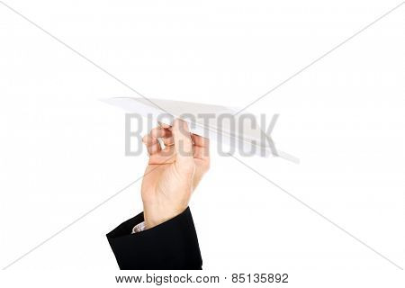 Close up on male hand throwing a paper plane.