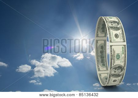 Wheel of dollars against cloudy sky with sunshine