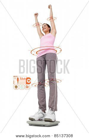 Young woman cheering on weight scale against fitness interface
