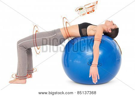 Side view of a fit woman stretching on fitness ball against fitness interface