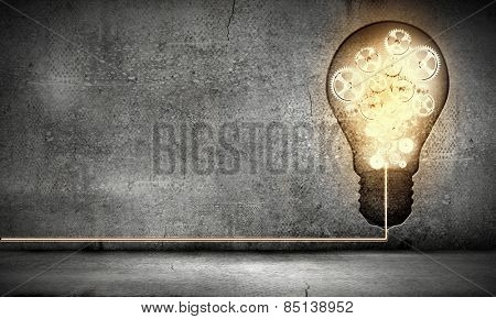 Conceptual image with light bulb and gears inside