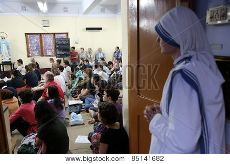 KOLKATA, INDIA - FEBRUARY 15: Sisters of Mother Teresa's Missionaries of Charity and volunteers from around the world at the Mass in the chapel of the Mother House, Kolkata, India at February 15, 2014