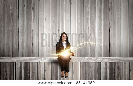 Young pretty lady with book in hands