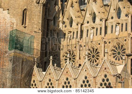 BARCELONA, SPAIN - DEC 23, 2014: Detail of a wall La Sagrada Familia - the impressive cathedral designed by Gaudi, which is being build since Mar 19, 1882 and is not finished yet.