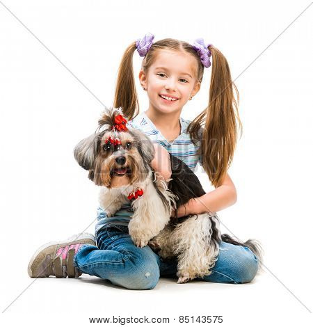 smiling little girl is with her dog Yorkshire Terrier isolated on white