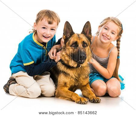 happy children with a shepherd dog isolated  on white