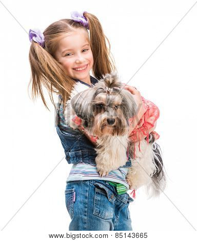Happy smiling little girl stand with her dog Yorkshire Terrier isolated on white