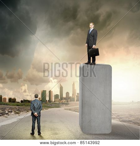 Businessman standing on bar and looking down at colleague
