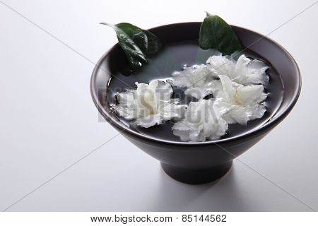 jasmine flowers in the black color bowl