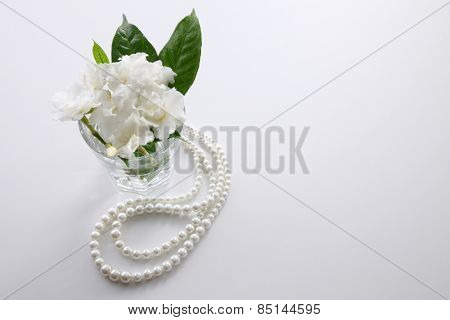 jasmine flowers and pearl necklace