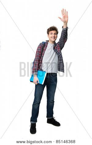 Full length portrait of a young male student waving his hand