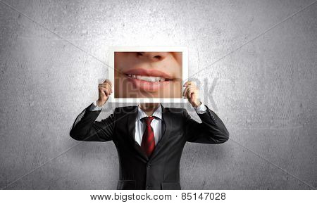 Unrecognizable businessman holding photo with smiling mouth