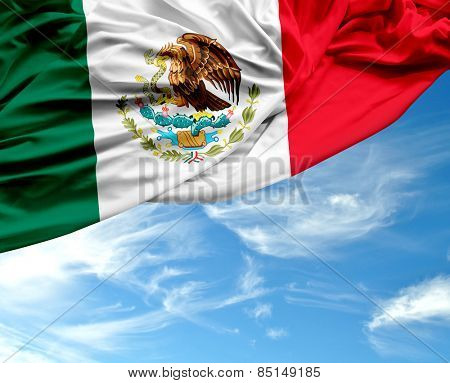Mexican waving flag on a beautiful day