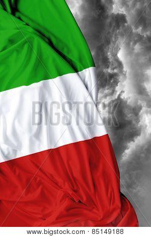 Italian waving flag on a bad day