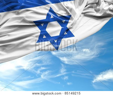 Israeli waving flag on a beautiful day