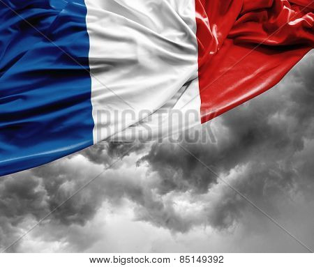 French waving flag on a bad day