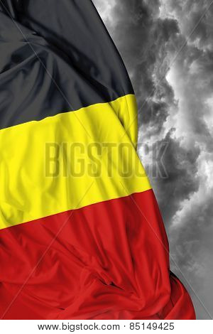 Belgian waving flag on a bad day