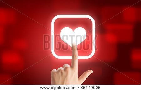 Close u of human hand pushing application icon