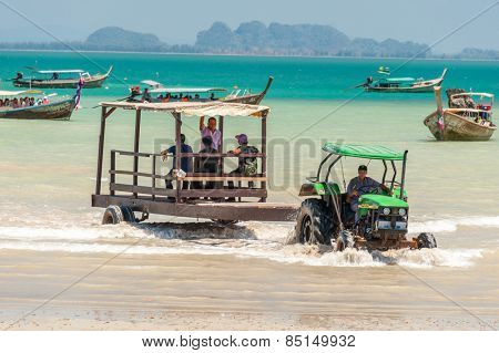 RAILAY, THAILAND - MARCH 13, 2014: Toutrists transport from mainland by boats to East Railay beach, one of the most popular rock climbing locations in Asia. on March 13, 2014. Railay, Krabi, Thailand