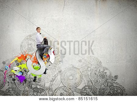 Young businessman with briefcase riding dollar symbol