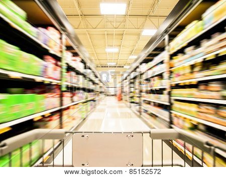 a blurred shot of an isle in a supermarket or grocery store shopping center