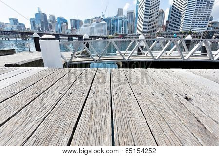 empty plank board and cityscape at harbor