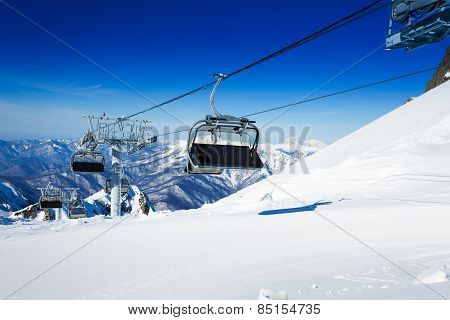 Ski chairlift over mountains on winter resort
