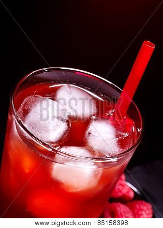 Red drink  with cube ice on dark background. Top view.