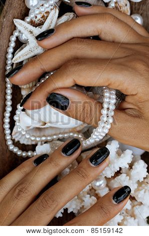 close up nails with manicure among sea stuff, shell, coral, star