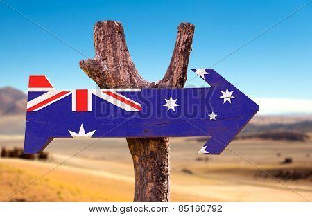 Australia Flag wooden sign with desert background