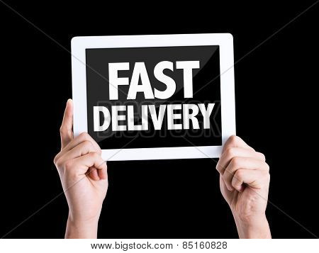 Tablet pc with text Fast Delivery isolated on black background